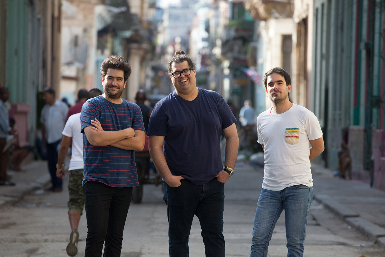 Members of the Harold López-Nussa Trio standing in street