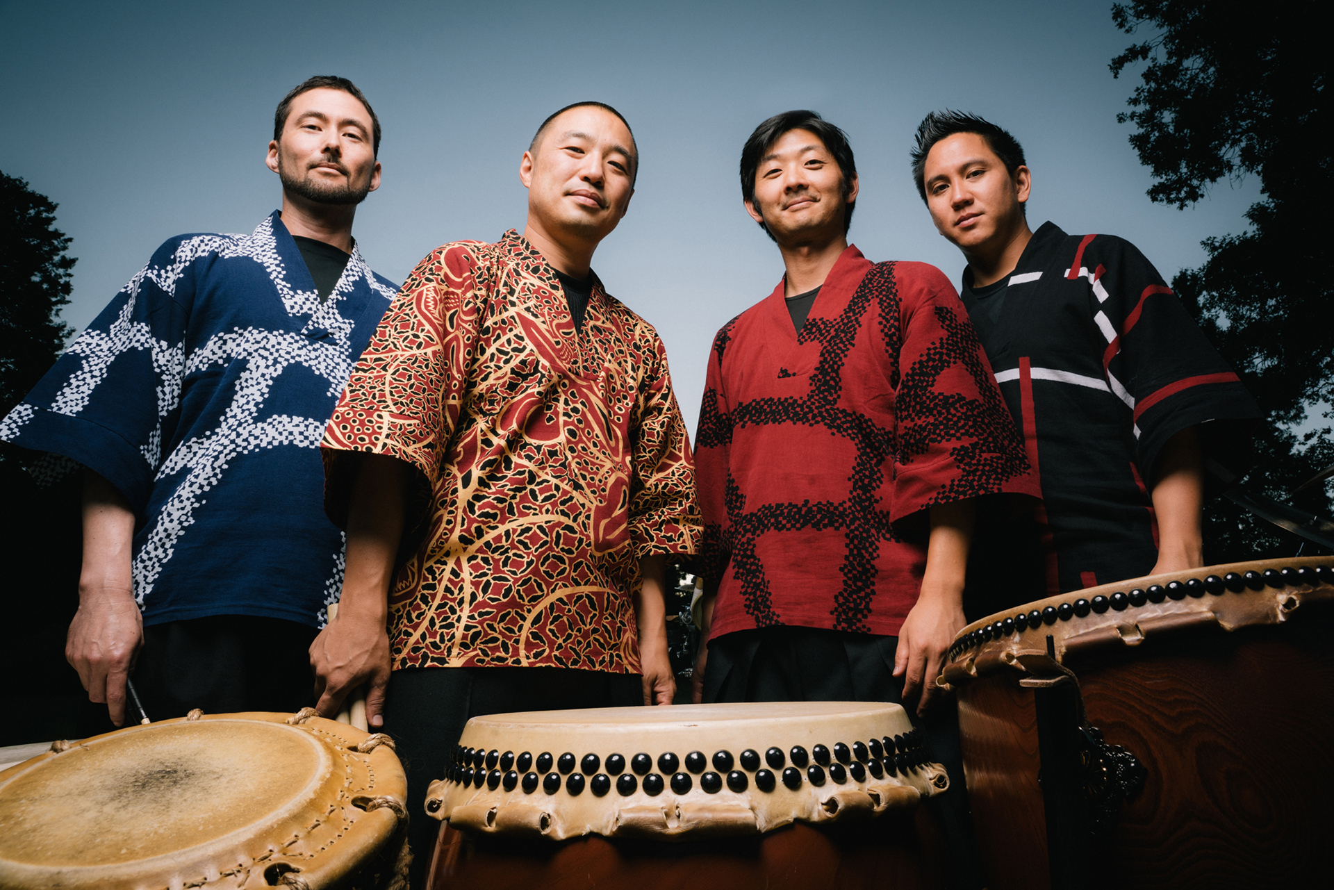 Members of On Ensemble posing with taiko drums