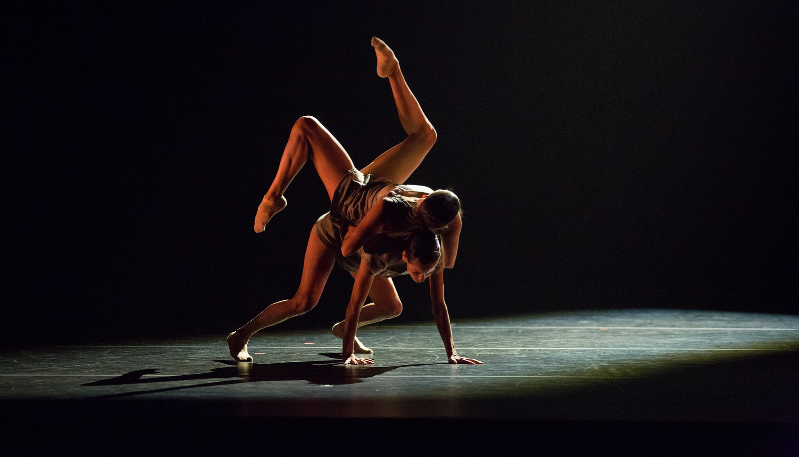 Two members of Aspen Santa Fe Ballet performing a lift on stage